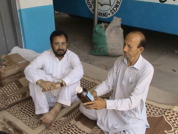 murad and asmat - Veterinary Camping Service at Bannu for Internally Displaced Persons of North Waziristan